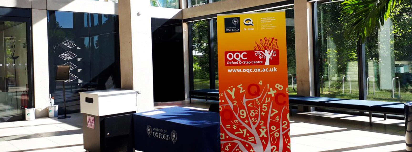 OQC event reception with banner, manor road building entrance hall