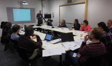 Group of ESRC teachers' workshop participants sitting in small classroom