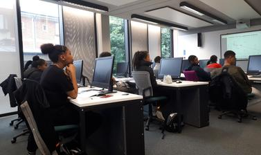 Group of Target Oxbridge participants sitting in computer lab room listening to presentation